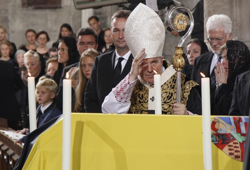 Austrian Cardinal Schoenborn blesses the coffin of Otto von Habsburg-Lothringen during the Requiem in Vienna