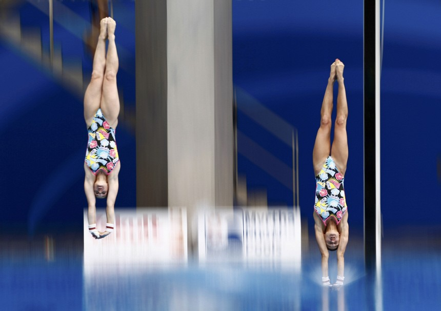 Germany's Steuer and Subschinski compete during women's 10m synchronised platform diving final at the 14th FINA World Championships in Shanghai