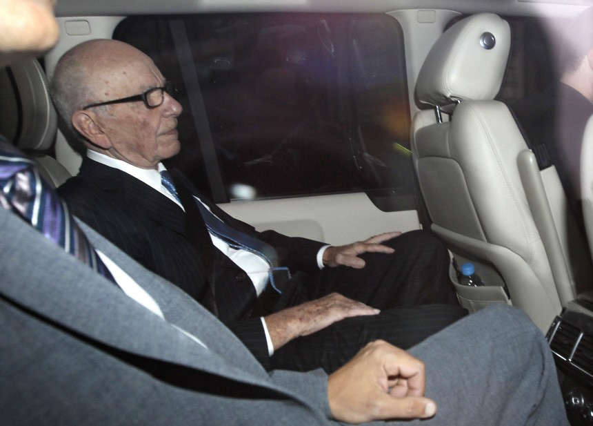 News Corp Chief Executive and Chairman Rupert Murdoch is driven from his home in London