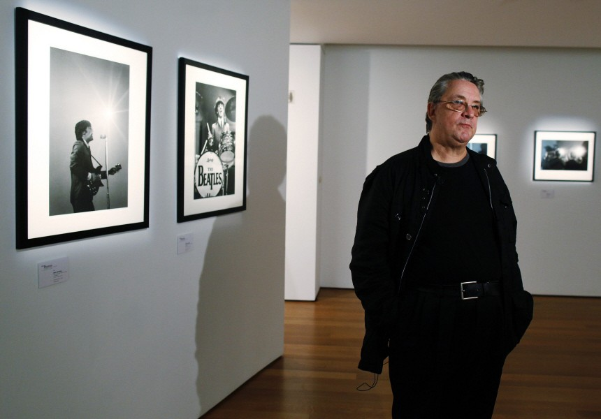 Photographer Mike Mitchell is interviewed during a press preview of 'The Beatles Illuminated: The Discovered Works of Mike Mitchell' at Christie's auction house in New York