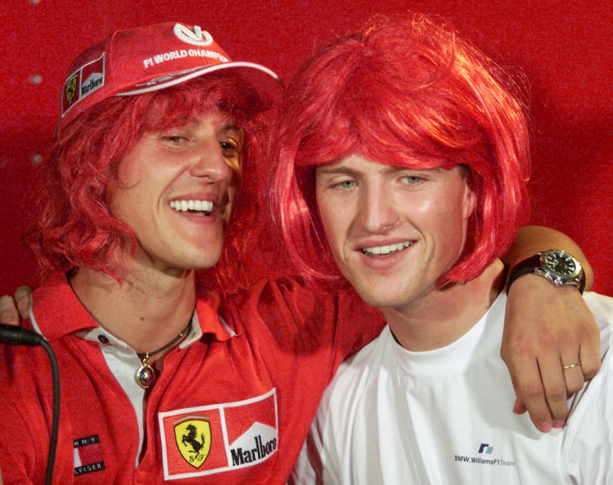 THE SCHUMACHER BROTHERS WEAR SCARLET WIGS IN SEPANG