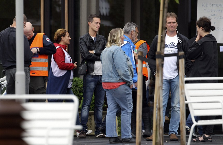 Rescue workers stand outside the hotel, where relatives of victims and survivors of a shooting which took place at a meeting of the youth wing of the Labour Party on Utoeya island have gathered, in Sundvollen