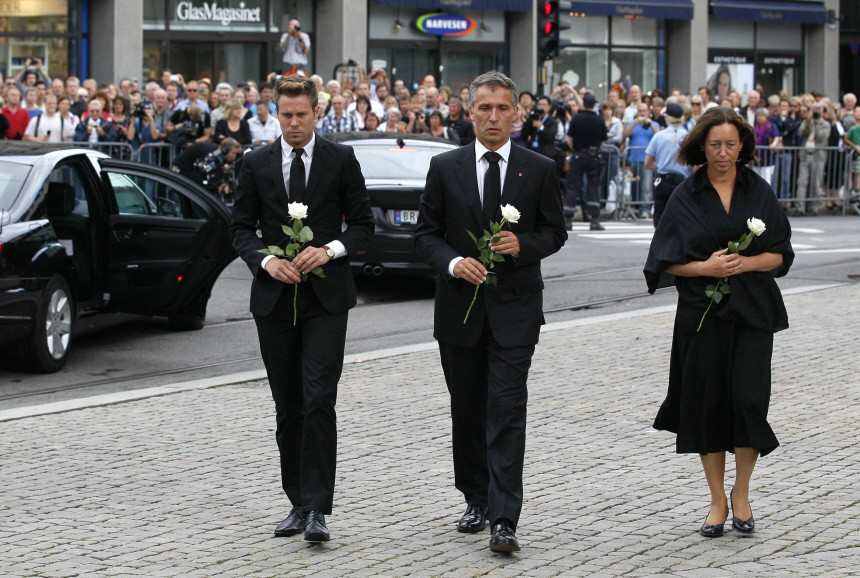 Norwegian PM Jens Stoltenberg, his wife Ingrid Schulerud and Eskil Pedersen, the leader of the youth wing of ruling Labour Party, arrive to attend a memorial service at a cathedral in Oslo
