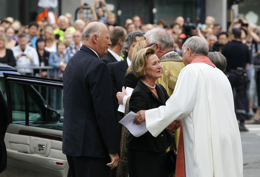Norwegian King Harald and Queen Sonja arrive to attend a memorial service at a cathedral in Oslo