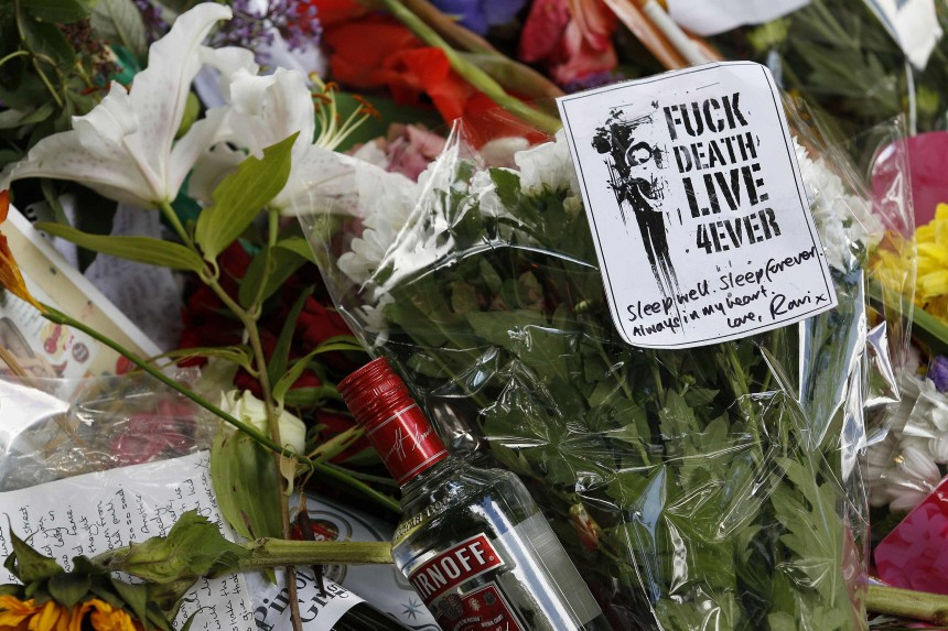 Flowers and tributes are seen outside the home of Amy Winehouse in London