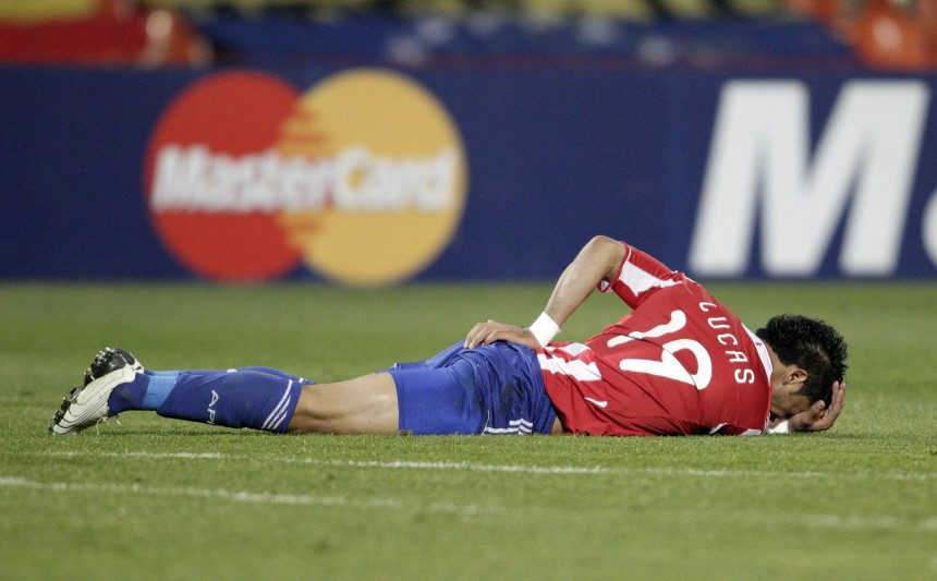 Paraguay's Barrios lies on the ground after colliding with a Venezuela's player during their semi-final soccer match at the Copa America in Mendoza