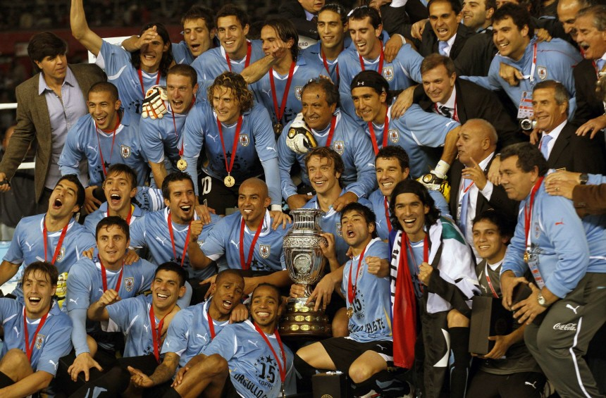 Uruguay's team celebrates after winning the Copa America final soccer match against Paraguay in Buenos Aires