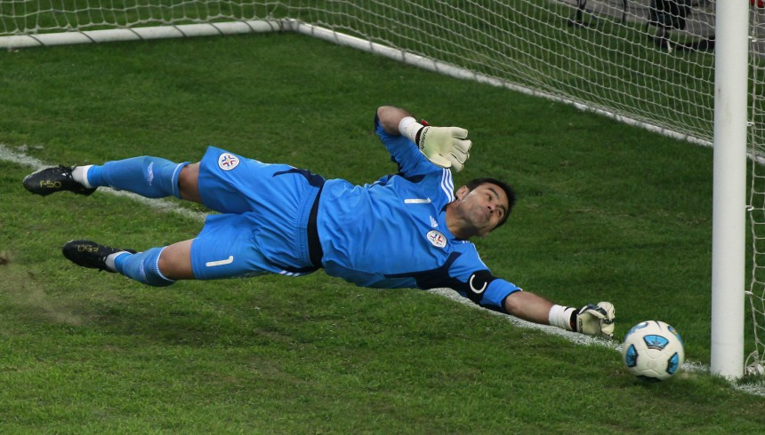 Paraguay's goalkeeper Justo Villar makes a save as they play Brazil in their quarter-final soccer match at the Copa America in La Plata
