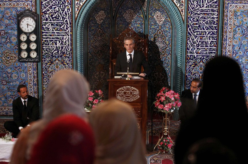 Norway's FM Store addresses inside the World Islamic Mission Mosque as Crown Prince Haakon looks on in Oslo