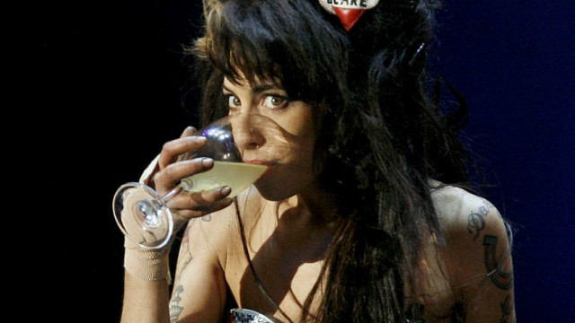 File photo of British singer Amy Winehouse drinking during her performance at 'Rock in Rio' music festival in Lisbon