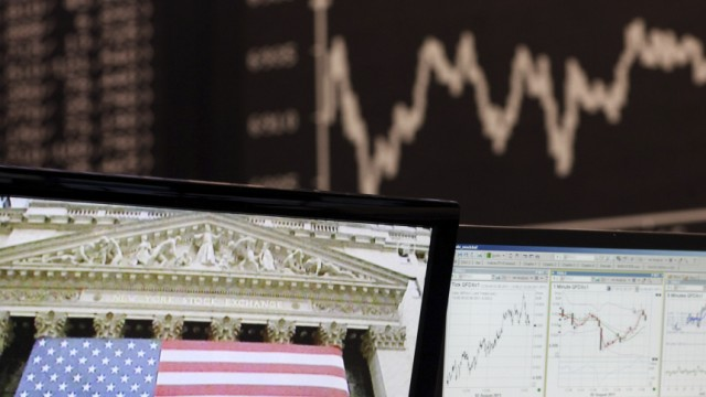 Computer displays are seen in front of the DAX Index board on the trading floor at Frankfurt's stock exchange