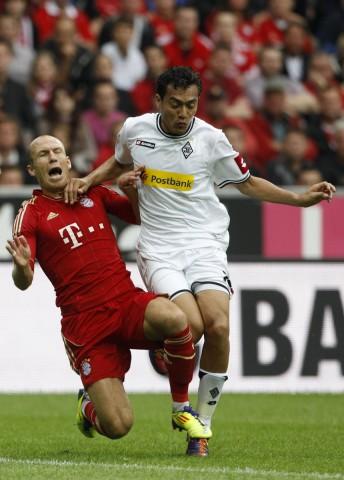 Bayern Munich's Robben is tackled by Arango of Borussia Moenchengladbach during German Bundesliga soccer match in Munich
