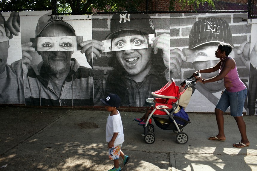 French Street Artist JR Installs Large Scale Portraits In The Bronx