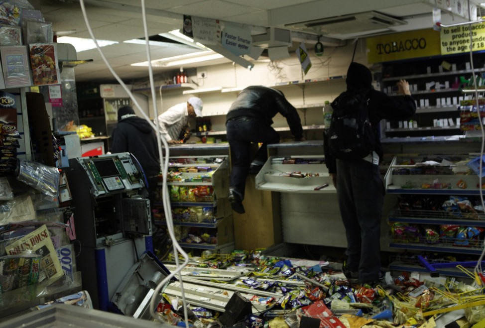 Looters rampage through a convenience store in Hackney, east London