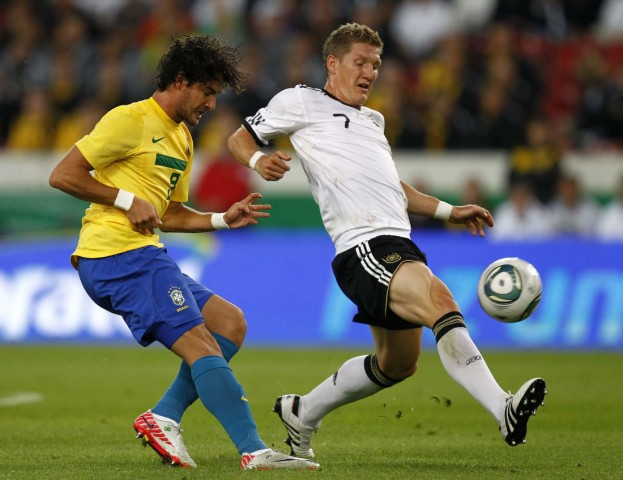 Schweinsteiger of Germany challenges Silva of Brazil during their friendly soccer match in Stuttgart