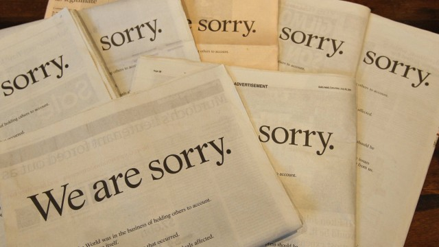 The Times, the Sun, the Guardian, the Financial Times, the Independent, the Daily Mail, and the Daily Telegraph newspapers are displayed featuring an apology from News Corp Chief Executive Murdoch at a cafe in London