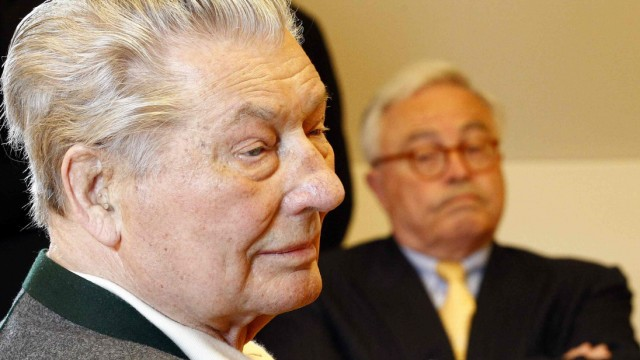 File photo of German businessman Kirch and former Deutsche Bank CEO Breuer sit in a Munich courtroom
