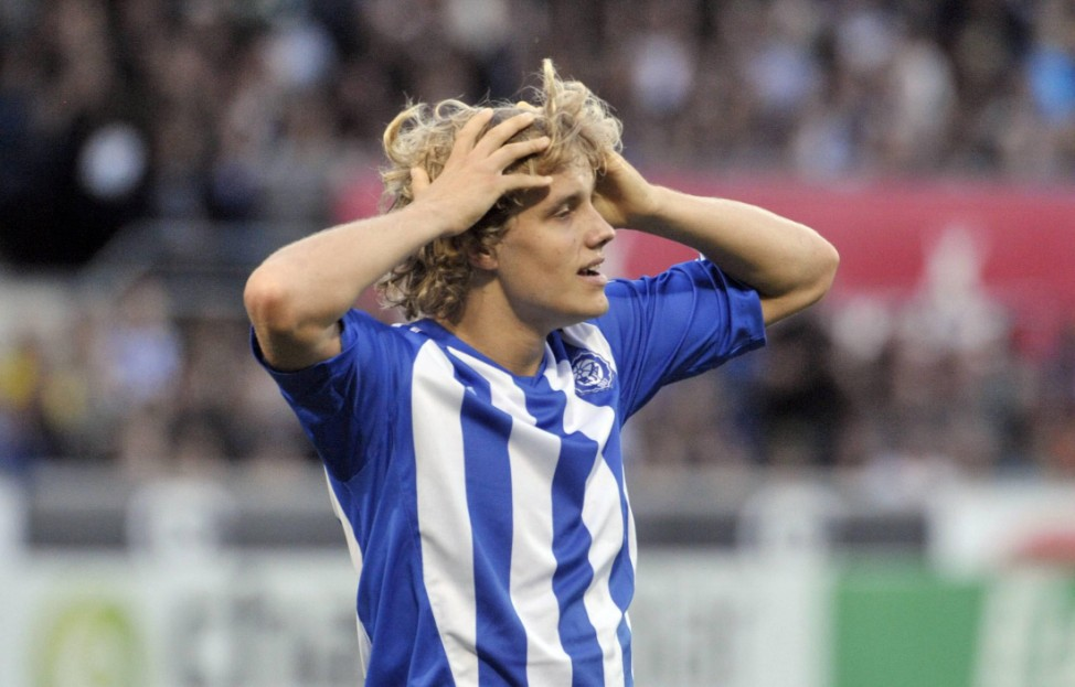 HJK Helsinki's Teemu Pukki celebrates his goal during the Europa League playoff first leg soccer match against Schalke 04 in Helsinki