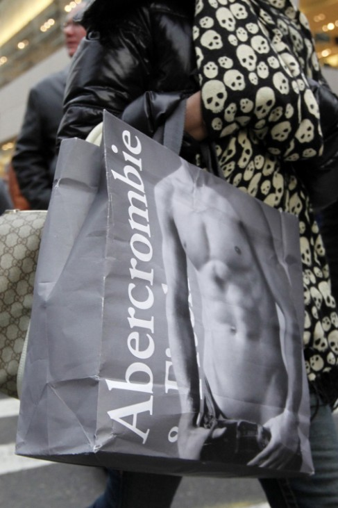 Shoppers carry bags as they walk down Fifth Avenue in New York