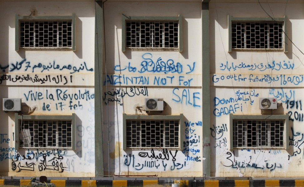 Libyan rebel graffiti covers a building in the main square in the town of Zintan in Libya's Western Mountains