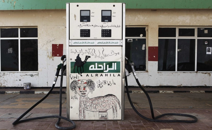 A fuel pump is defaced with a graffiti caricature of Muammar Gaddafi in the rebel-held town of Ajdabiyah