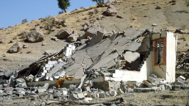 A collapsed building is seen in Dahuk province after Turkish warplanes backed by heavy artillery struck Kurdish guerrilla targets in northern Iraq