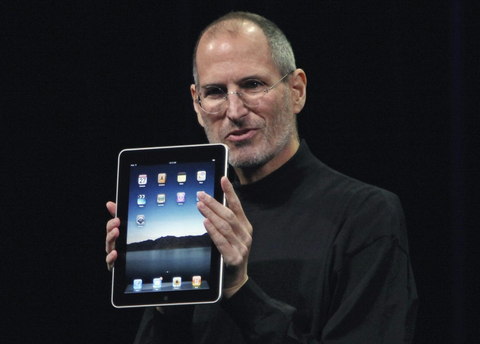 File photo of Apple Chief Executive Officer Steve Jobs holding the new 'iPad' during the launch of Apple's new tablet computing device in San Francisco, California