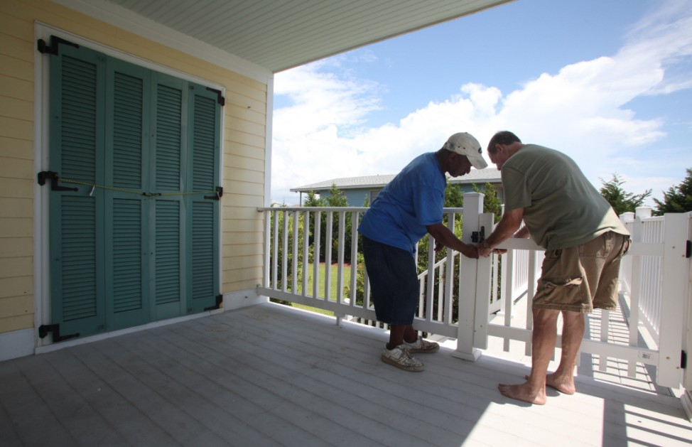 Residents work to secure Norris family beach home prior to the arrival of Hurricane Irene