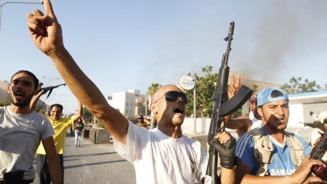 Libyan rebel fighters celebrate after pushing back Muammar Gaddafi's forces in Abu Salim district in Tripoli