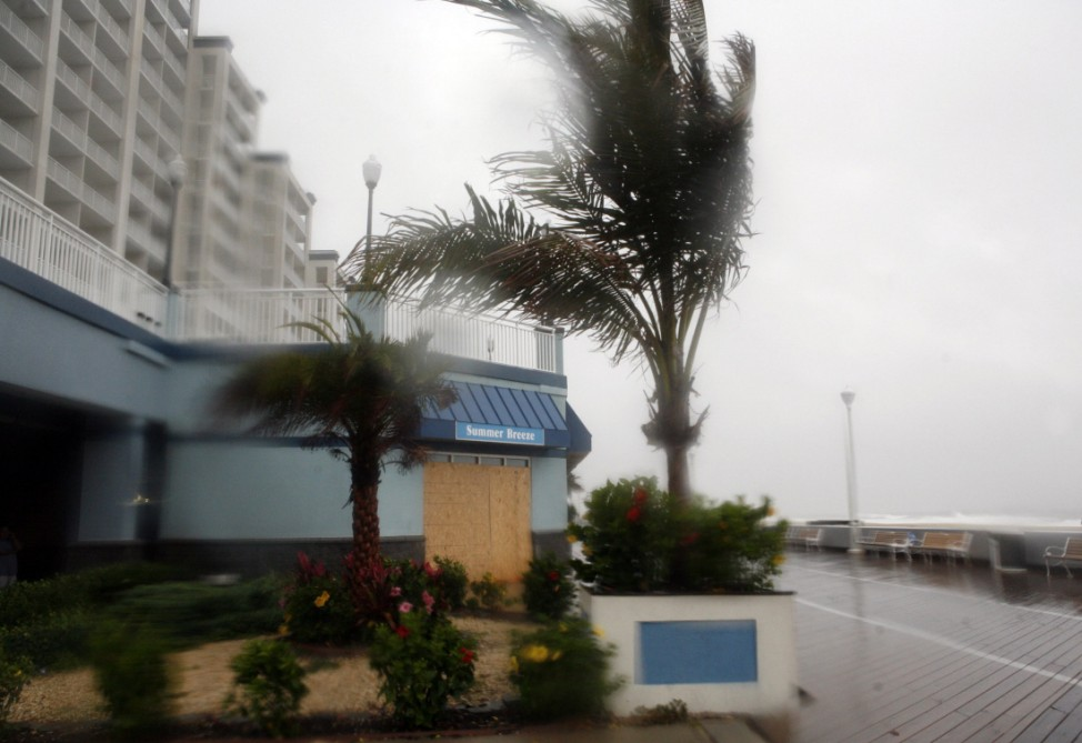 Trees are blown by the wind and rain from Hurricane Irene on the empty board walk in Ocean City