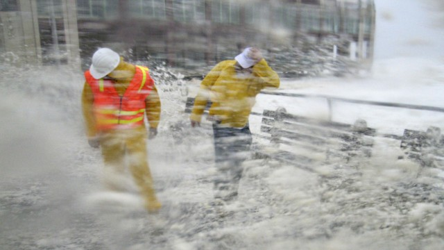 Brian Grant and Bob Bianchini, engineers from the public works department out for a safety inspection, are slammed by waves and storm surge pounding the boardwalk and the beach at first light as Hurricane Irene slams into Asbury Park
