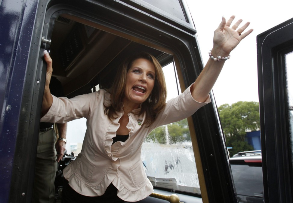 U.S. Republican presidential candidate and Minnesota Congresswoman Bachmann waves to a crowd from her campaign bus as she leaves Cafe Versailles