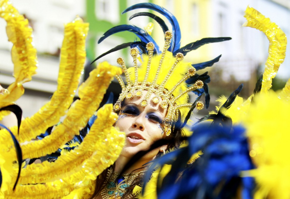 A performer dances in the street parade at the annual Notting Hill Carnival in central London