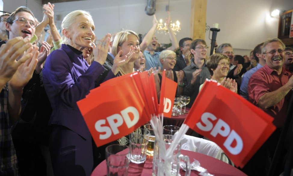 Supporters of SPD top candidate Sellering react after hearing first exit polls for the Mecklenburg-Vorpommern state election in Schwerin