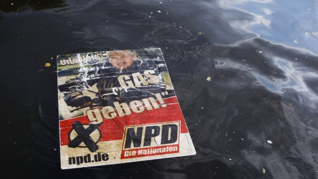 Election poster of far-right NPD party floats in canal in Berlin Kreuzberg