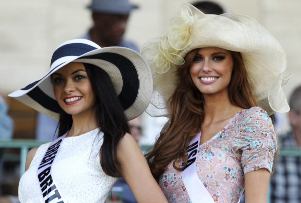 Miss USA Alyssa Campanella and Miss Great Britain Chloe-Beth Morgan pose for a photograph as they visit the Jockey Club horse race track in Sao Paulo