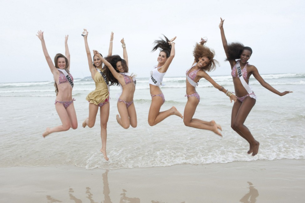 Miss Universe contestants pose for a photo on the beach in Guaruja, Brazil