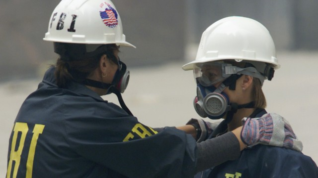 FBI AGENTS COMFORT EACH OTHER AT SITE OF WORLD TRADE CENTER DISASTER