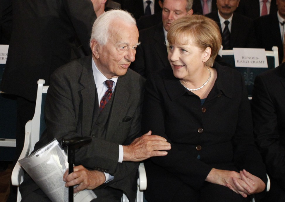German Chancellor Merkel talks with former President von Weizsaecker during ceremony marking 50th anniversary of Bergedorfer Forum of Koerber Foundation in Berlin