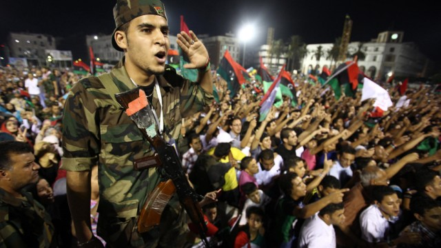 A Libyan rebel attends a celebration rally upon the arrival of Na