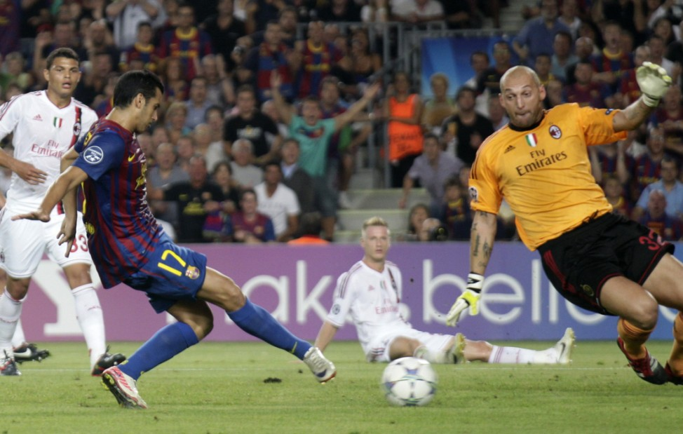 Barcelona's Pedro kicks the ball to score against AC Milan's goakeeper Abbiati during their Group H Champions League soccer match in Barcelona