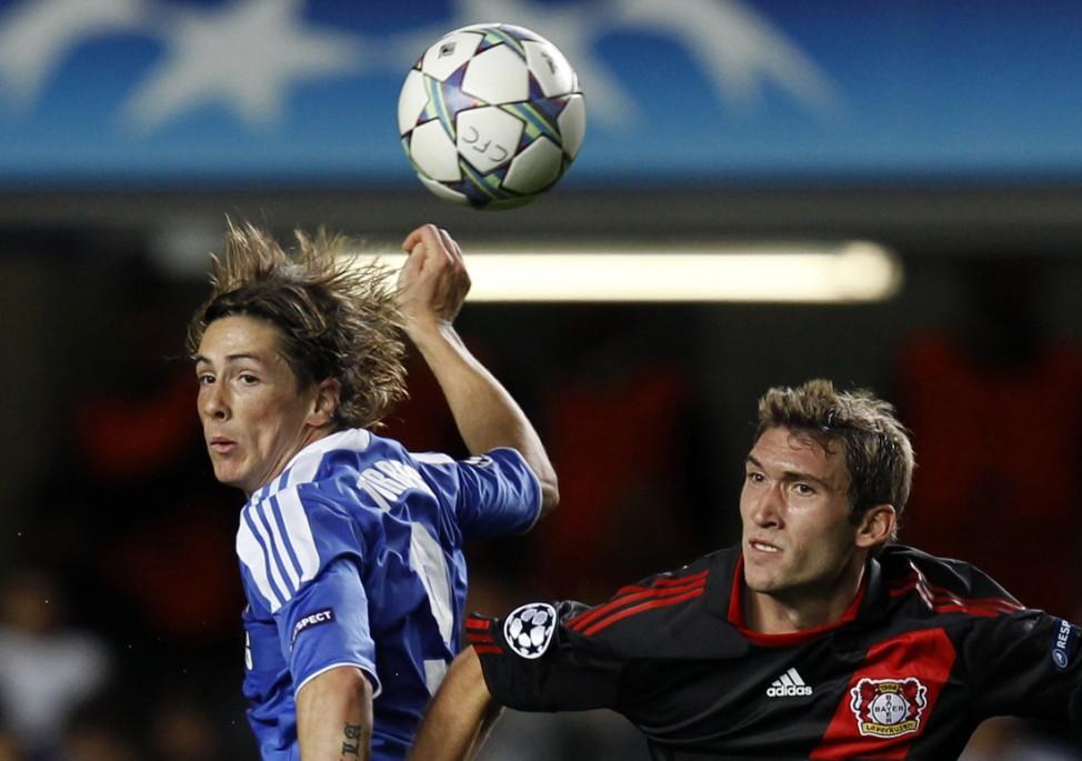 Chelsea's Fernando Torres challenges Bayer Leverkusen's Stefan Reinartz during their Champions League Group E soccer match at Stamford Bridge in London