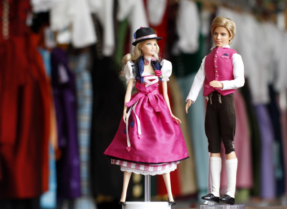 Barbie and Ken dolls dressed in traditional Dirndl and leather trousers are pictured in Dirndl tailoring shop in Munich