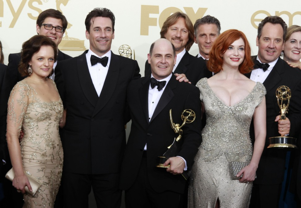 Executive producer Weiner holds the award for outstanding drama series for 'Mad Men' at the 63rd Primetime Emmy Awards in Los Angeles