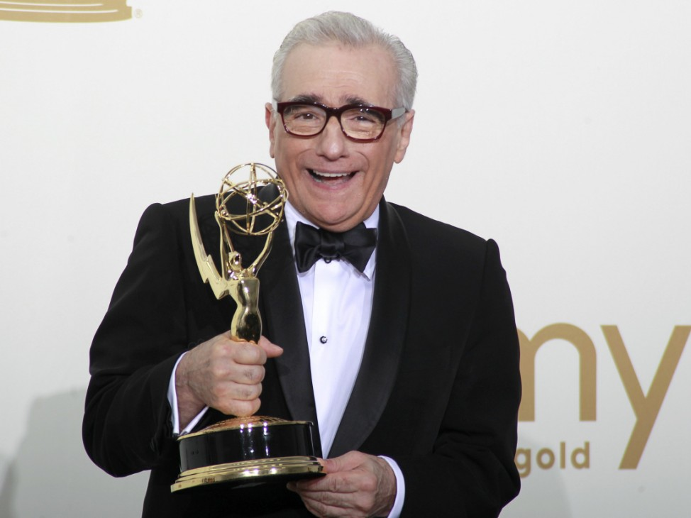 Martin Scorsese holds his Emmy award backstage in Los Angeles