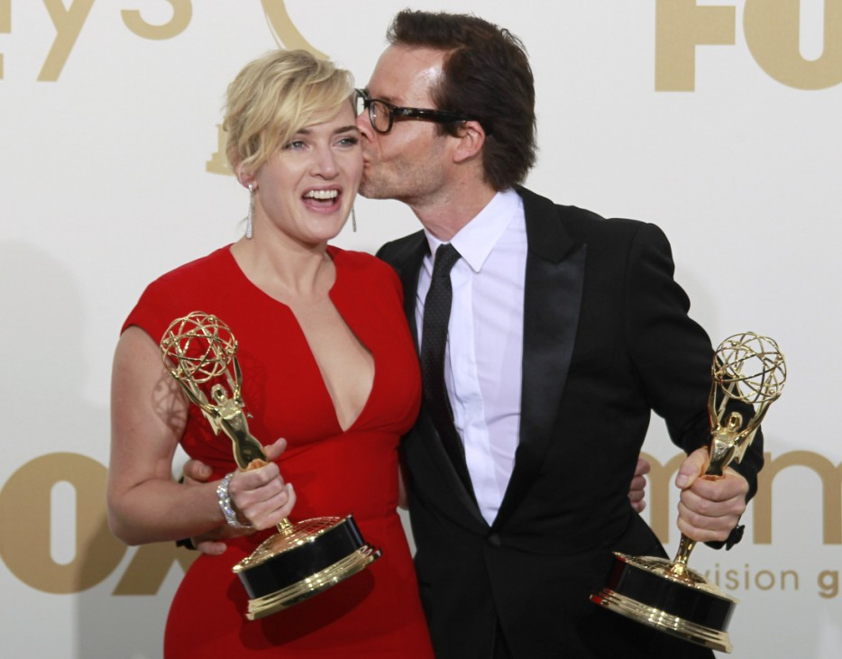 Actress Winslet gets kiss from co-star Pearce at the 63rd Primetime Emmy Awards in Los Angeles