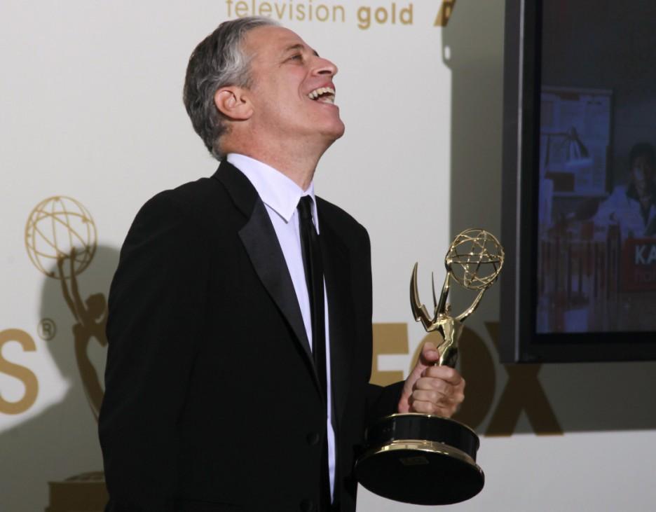 Jon Stewart holds an Emmy award in Los Angeles