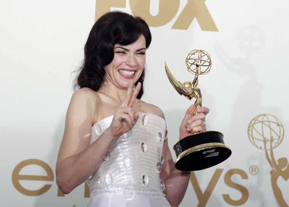 Actress Margulies holds her Emmy award backstage after winning for outstanding lead actress in a drama series for 'The Good Wife,' at the 63rd Primetime Emmy Awards in Los Angeles