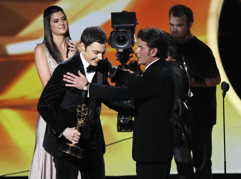 Actor Parsons accepts the award for outstanding lead actor in a comedy series from presenter Charlie Sheen at the 63rd Primetime Emmy Awards in Los Angeles