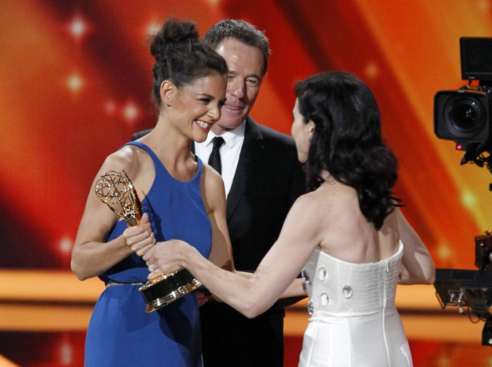 Julianna Margulies accepts award from presenters Katie Holmes and Bryan Cranston at the 63rd Primetime Emmy Awards in Los Angeles